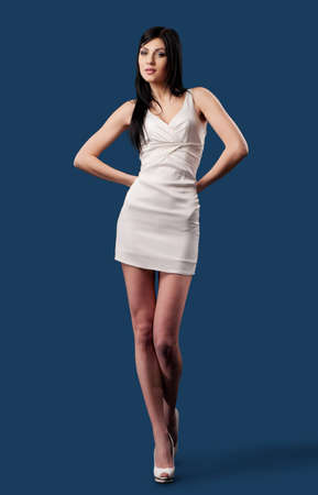 pretty girl in white dress against a dark background Stock Photo - 14114621