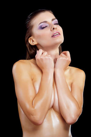 Beautiful young naked woman isolated on black Stock Photo - 14680295
