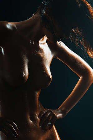 Beautiful young naked woman isolated on black Stock Photo - 14680290