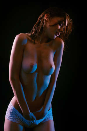 Beautiful young woman isolated on black