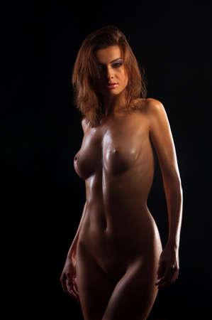 low key image of sexy woman body on black Stock Photo