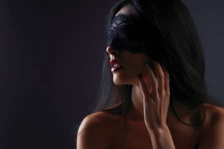 portrait of a girl in a mask with a gray background Stock Photo - 15042200
