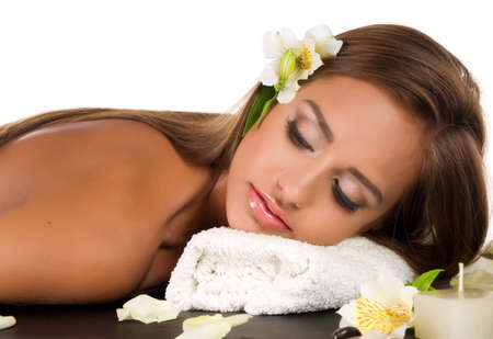 Beautiful young woman having a massage in a spa Stock Photo - 15144971