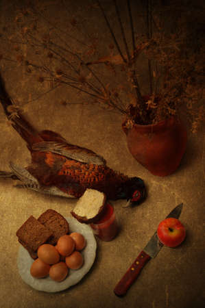 Art still life with a pheasant and bread photo