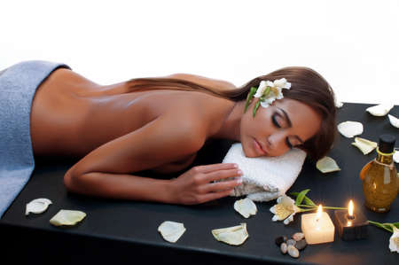 Beautiful young woman having a massage in a spa Stock Photo - 15477111