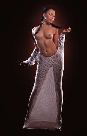 Fashion portrait of nude woman with beautiful slim body