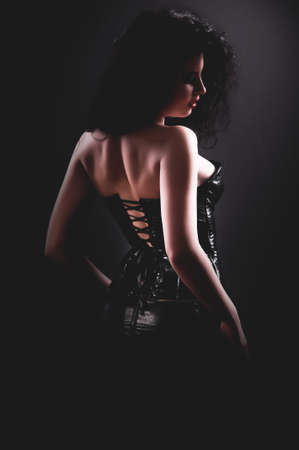Slim sexy woman with hourglass figure in black leather corset Stock Photo - 15959100