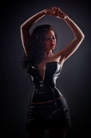 Slim sexy woman with hourglass figure in black leather corset Stock Photo - 16293443