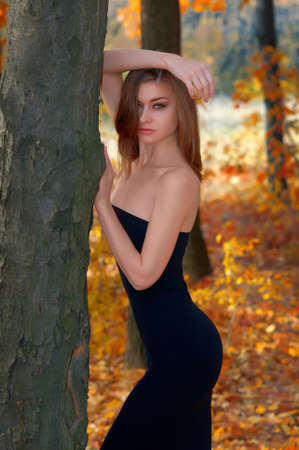 fur trees: Portrait of a hot young woman in autumn park Stock Photo