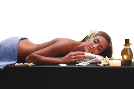 Beautiful young woman having a massage in a spa Stock Photo - 16293317