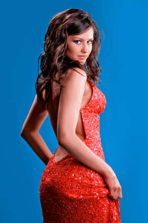 brunette woman in a red dress on a blue background Stock Photo - 16364934