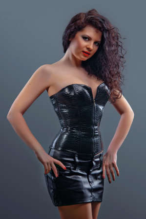 Slim sexy woman with hourglass figure in black leather corset Stock Photo - 16513969