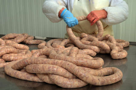 Meat plant traditional sausage during the preparation photo