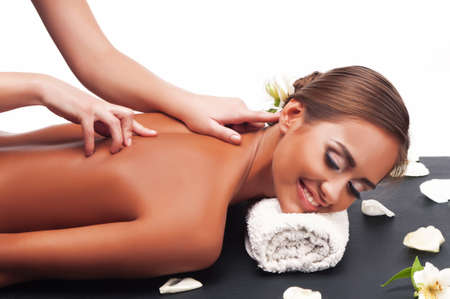 Beautiful young woman having a massage in a spa Stock Photo - 16880550