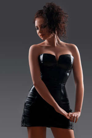 Slim sexy woman with hourglass figure in black leather corset Stock Photo - 17445087