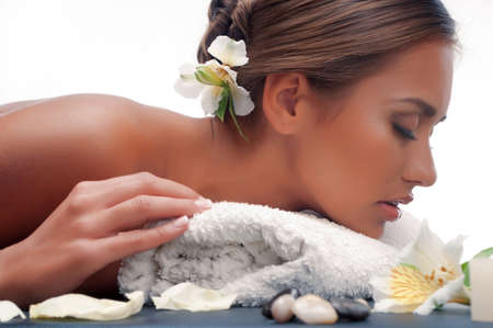Beautiful young woman having a massage in a spa Stock Photo - 17506380