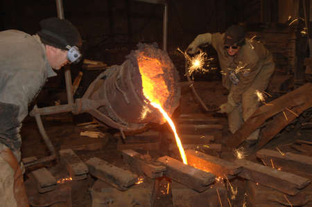 mined: Foundry - molten metal poured from ladle into mould - lost wax casting