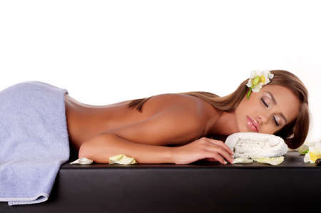 Beautiful young woman having a massage in a spa photo