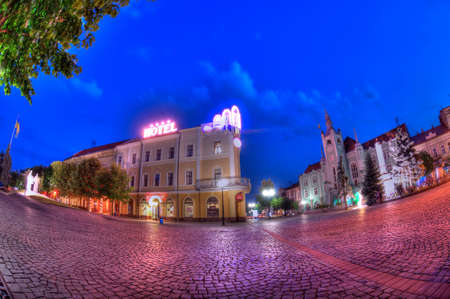 Night panorama of the center of Mukachevo city Ukraine
