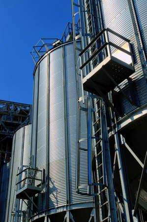 galvanised: Galvanised Iron grain silos on a farm in Eastern Europe Stock Photo