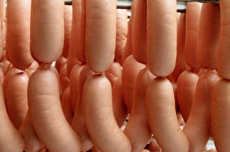 Lots of traditional sausage hanging in the warehouse photo