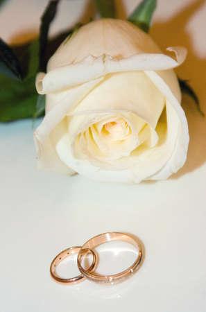 Two Golden Wedding Rings on table macro shot photo