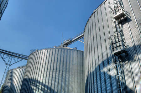 Galvanised Iron grain silos on a farm in Eastern Europe photo
