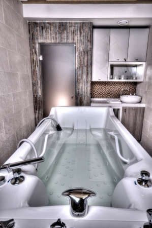 Spa Bathtub in a marble bathroom. photo