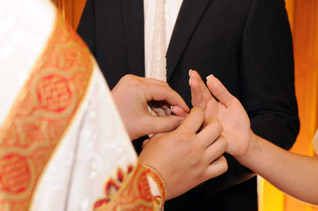 The groom and the bride. Wedding ceremony in church photo