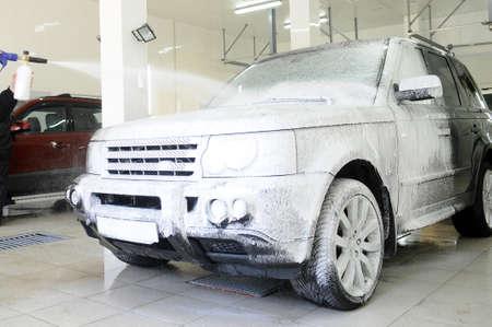 car covered in foam at the carwash Standard-Bild