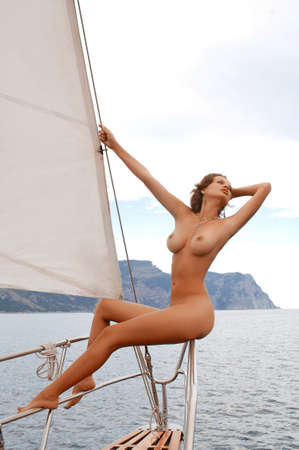 beautiful naked woman on board a yacht photo