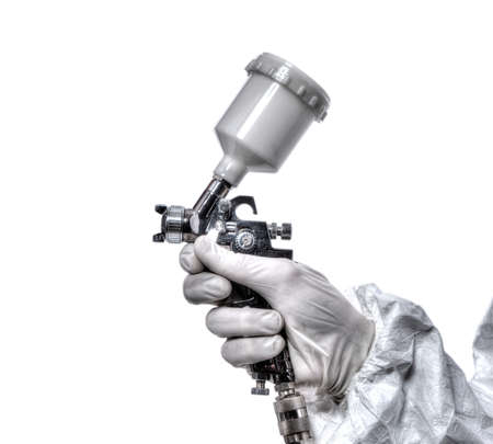 Worker with airbrush gun, isolated on white background photo