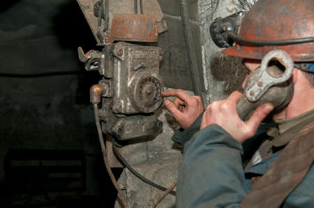 old mining building: conversation miner, old phone in the mine