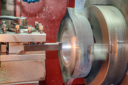 turning operation: Facing operation of a metal blank on turning machine with cutting tool