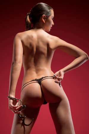 beautiful naked brunette on the red  photo