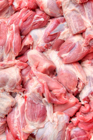 mass storage: Blocks of the fresh meat lay on the shopboard, close-up Stock Photo