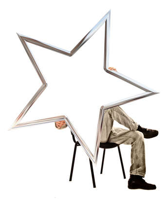 man sitting on a chair and holding a five-pointed star on a white background photo