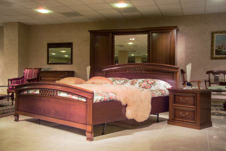 luxury double bed in classic style surrounded by furniture