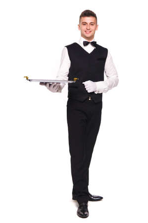 full length portrait of young happy smiling waiter with empty tray isolated on white background