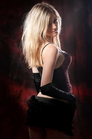 Portrait of beautiful and sexy woman on a dark background photo