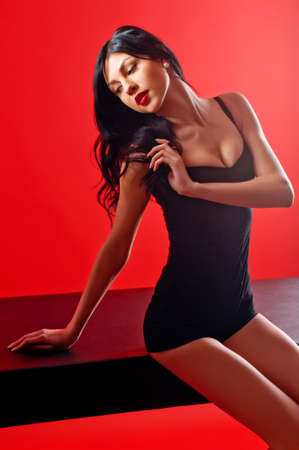 Fashion portrait of young beautiful female model. Glamour women with long black hair and sexy hairstyle. photo