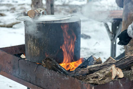 shurpa - soup with meat and potato on the fire photo