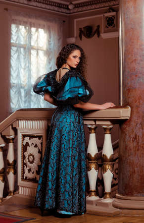 Beautiful women in the clothing of the 18th century in a luxurious interior photo