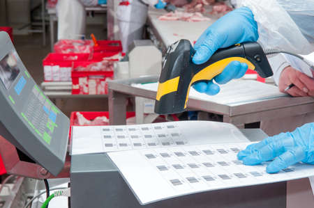 assignment of goods barcode at the factory meat Stock Photo