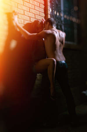 A shot of a man and a woman in love kissing