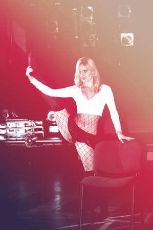 Sexy girl dancing strip-tease in the nightclub photo