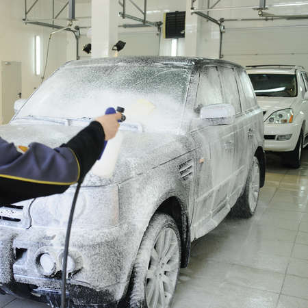 muck: car covered in foam at the carwash Stock Photo