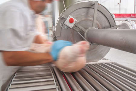 close up of meat processing in food industry Stock Photo