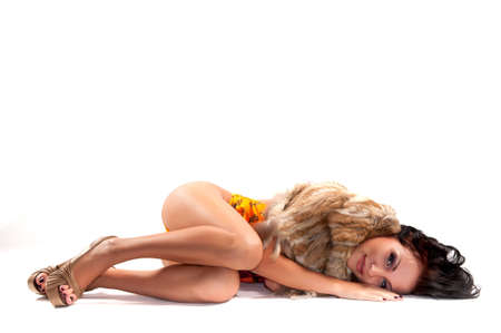 sexy panties: beautiful woman lying on a light background