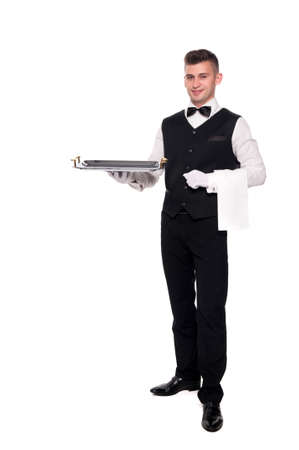 servant: A waiter or bartender, or servant holding a silver tray and smiling. White background.